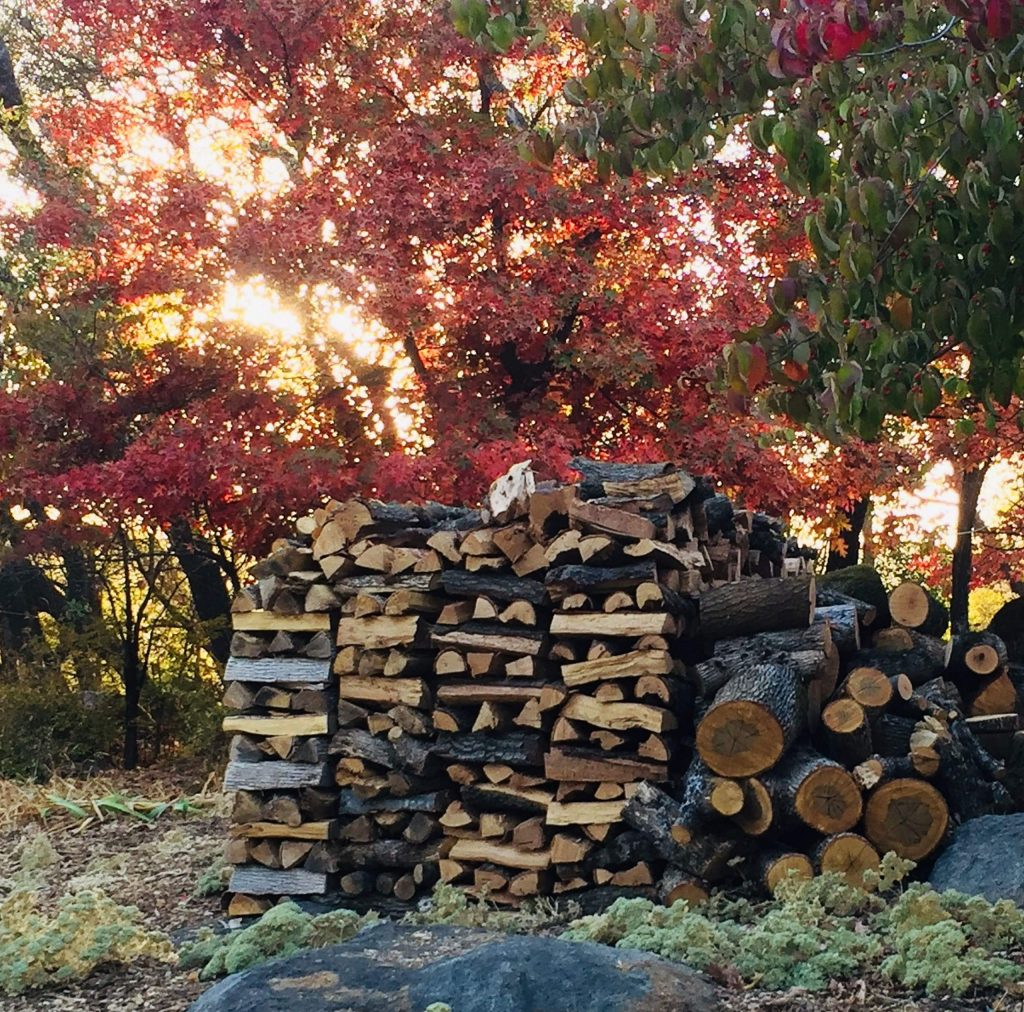 Sunset with wood stack in Penn Valley.