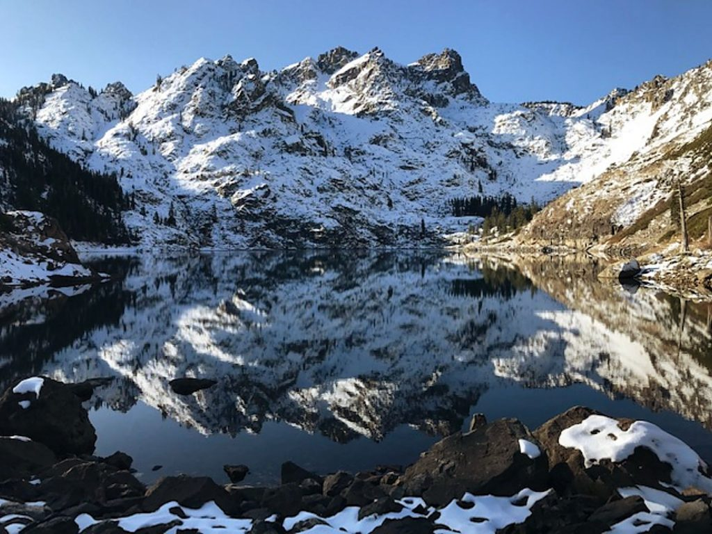 The Sierra Buttes reflected in Upper Sardine Lake overwhelming on a scintillating, super glorious Sunday.
