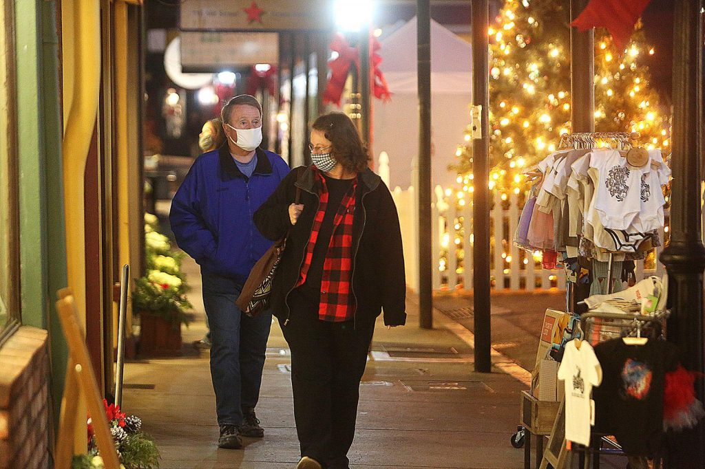 A pair of downtown Grass Valley shoppers take to Mill Street Saturday evening.