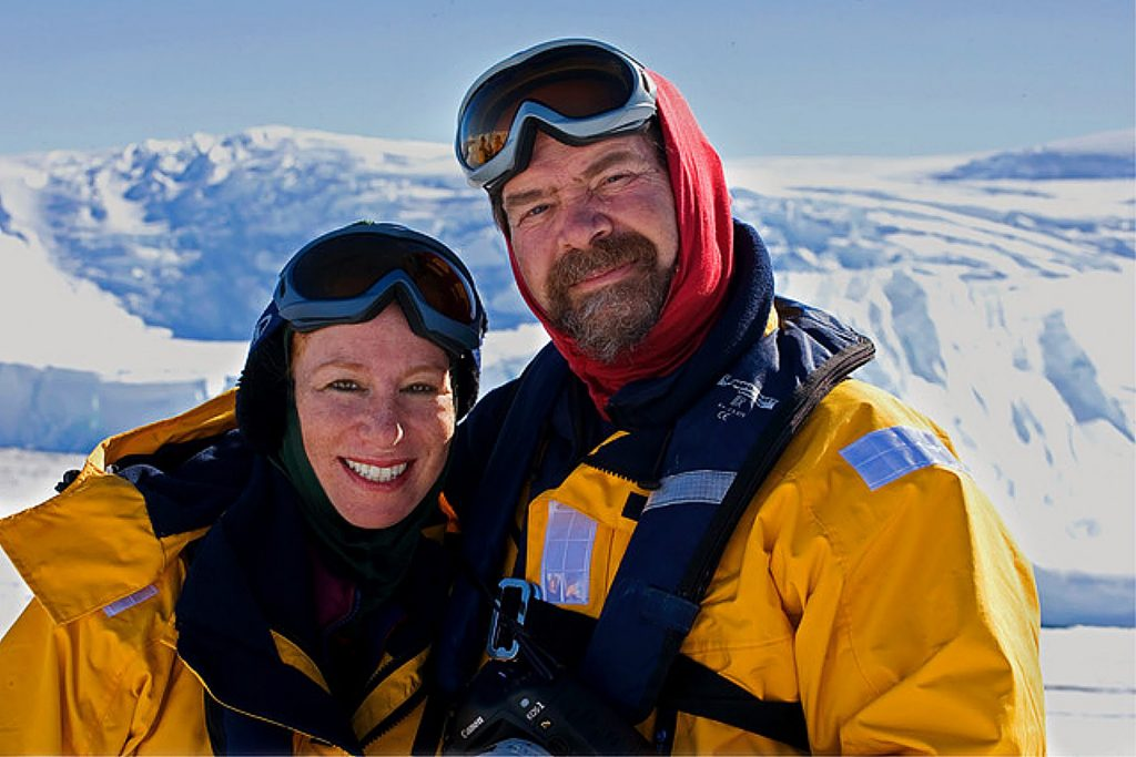 Mindy and her husband Roger on an iceberg in Antarctica. Photos from their travels in Antartica are on display and available for purchase at Twin Star Gallery.