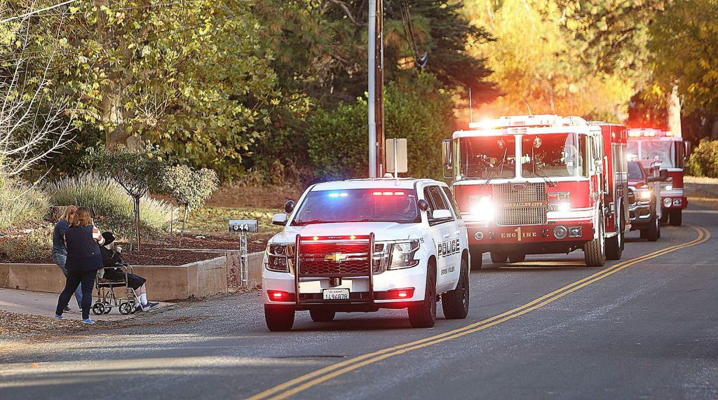 A procession of emergency service vehicles leads Thursday afternoon's birthday parade for 33-year-old Skyler Monahan-Tonti.