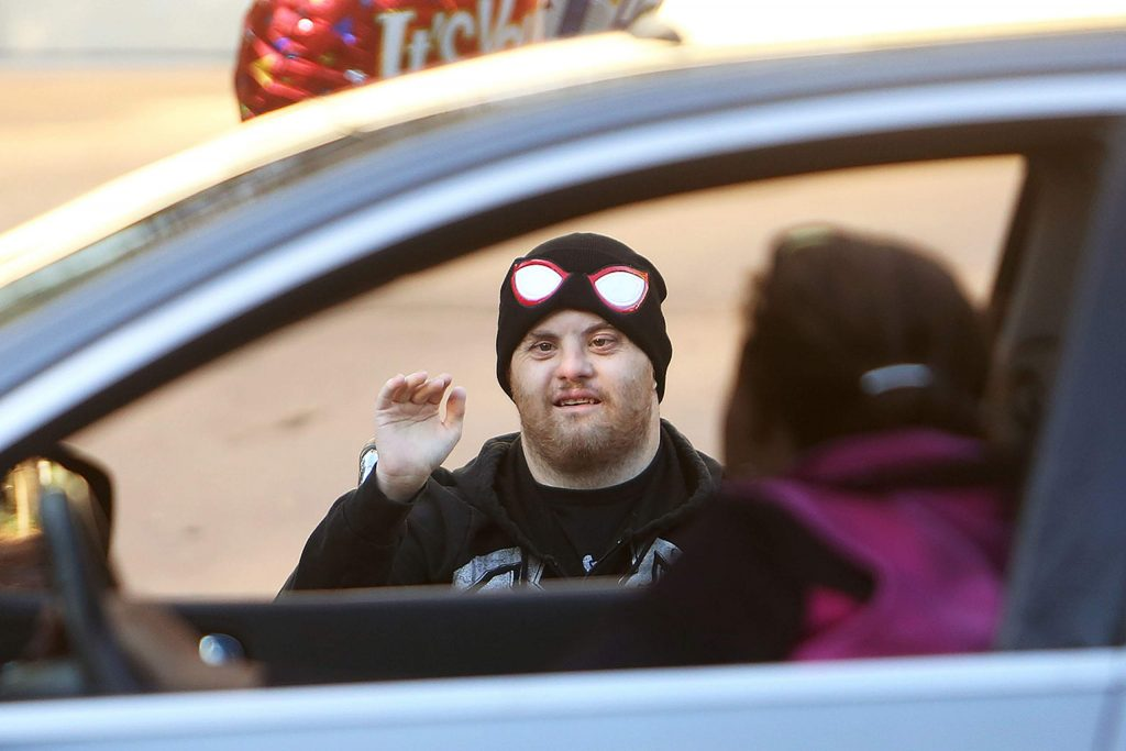 Skyler Monahan-Tonti waves to members of the community that turned up to wish him a happy birthday in front of his Butler Street home in Grass Valley. Monahan-Tonti turned 33 Thursday.