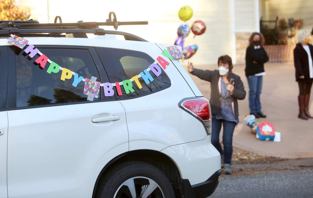 Vehicles adorned with decorations pass by and honk their horns for Monahan-Tonti Thursday off Butler Street in Grass Valley.