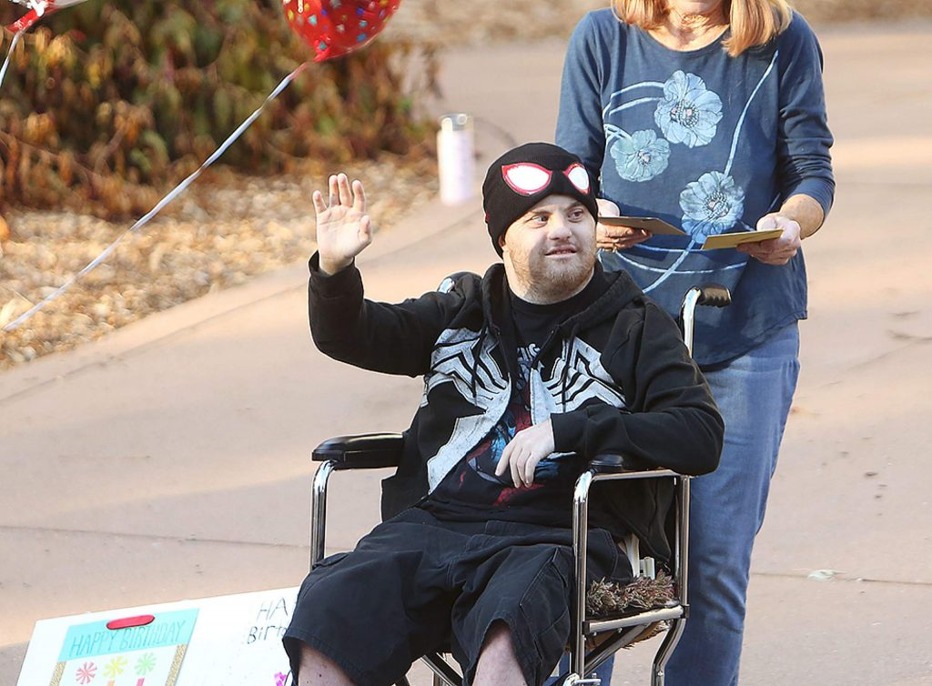Skyler Monahan-Tonti waves to vehicles wishing him a happy birthday from his driveway Thursday.