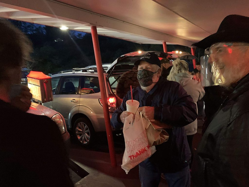 Jack Clute, left, and Bill Fox lend at hand at the Nov. 18 food donation and volunteer appreciation drive-in event at Big A Root Beer Drive-In in Grass Valley.