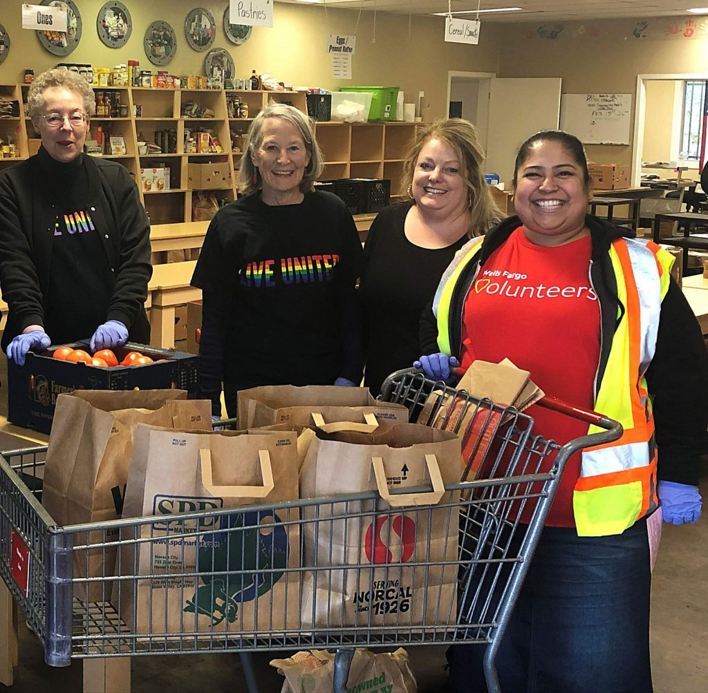 The Food Access Saturday holiday food distribution for families in need is set for Saturday in Grass Valley. Pictured are volunteers helping out at a food distribution prior to safety protocols that have since been implemented due to COVID-19.