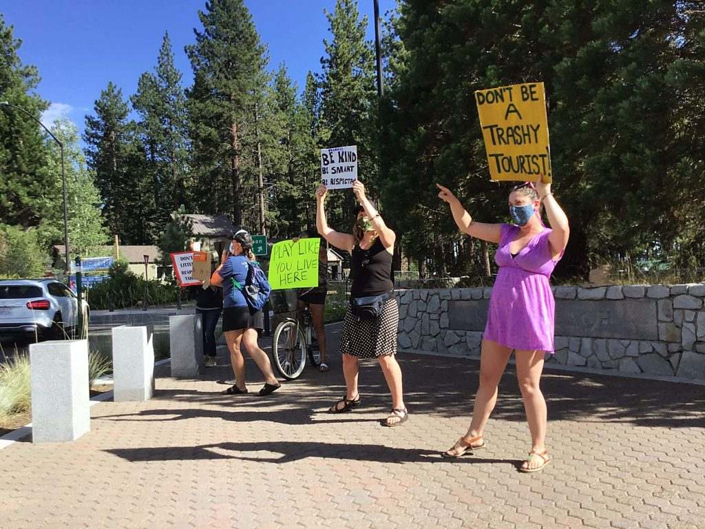 Locals at Kings Beach protest the amount of litter being left behind on Tahoe's beaches during August roundabout protests in Truckee and Lake Tahoe.
