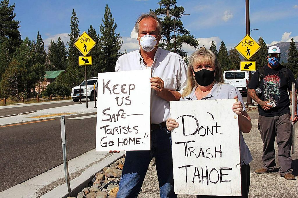 Protestors held signs as motorists entered South Lake Tahoe on Aug. 14. The Tahoe Mobility Forum, held in September, sought to find short- and long-term ways to reduce vehicle miles traveled during peak visitation periods.