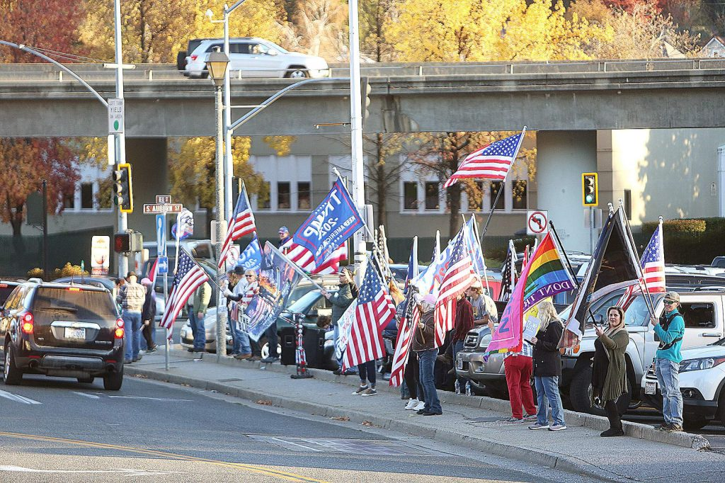 The Back the Blue Truth for Trump election results protesters waved flags as folks honked horns and waved on the corner of Neal and South Auburn Streets in Grass Valley Saturday afternoon.