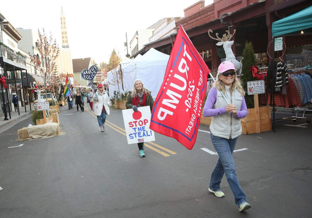 Election results protesters walk along Mill Street Saturday in the Back the Blue Truth for Trump parade.