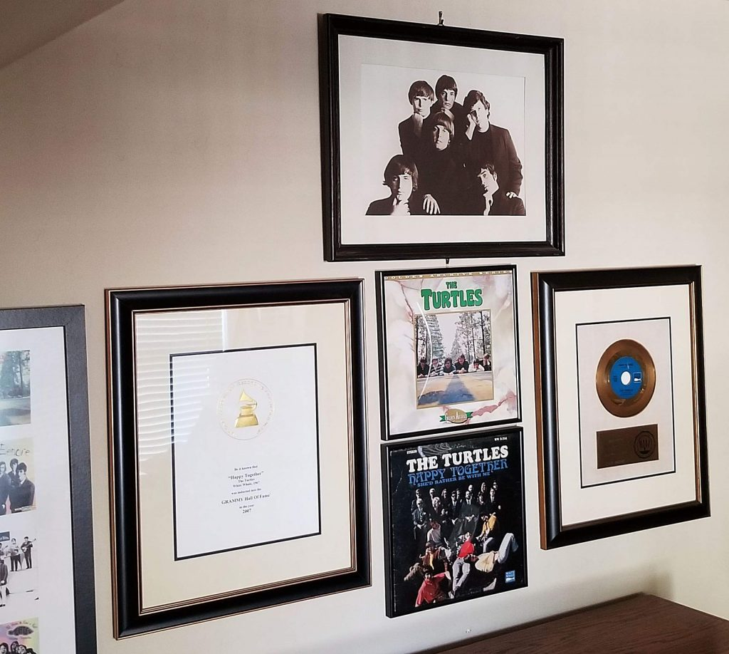 A wall in Jim Tucker's home is adorned with musical memories.