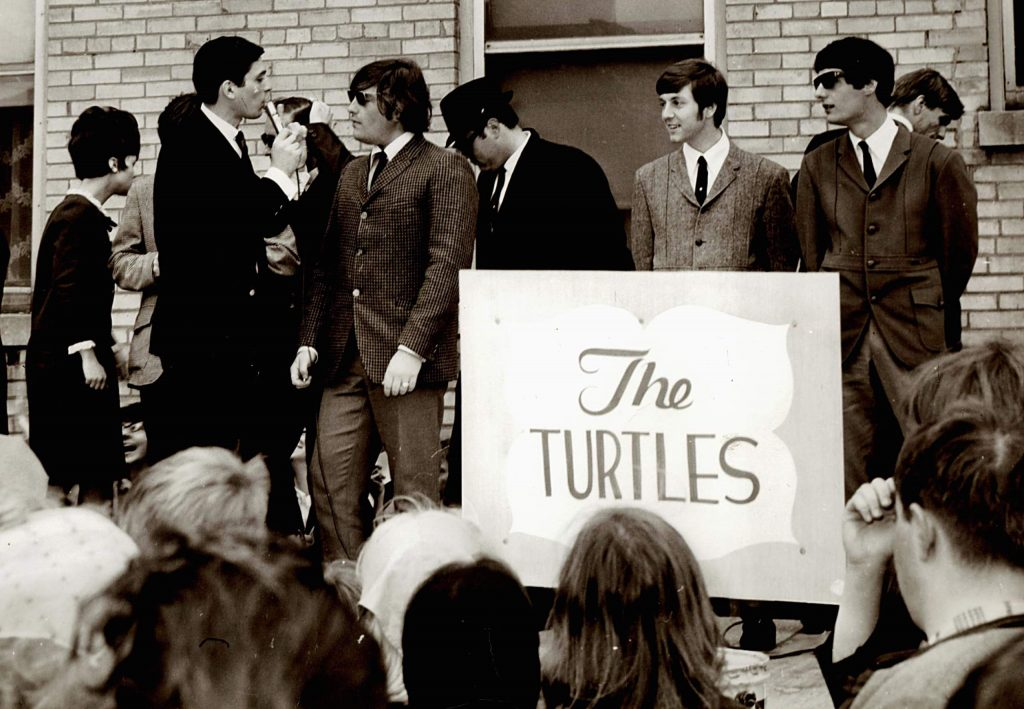Rhythm guitarist of The Turtles, Jim Tucker, far right, traveled the world with the award-winning band.