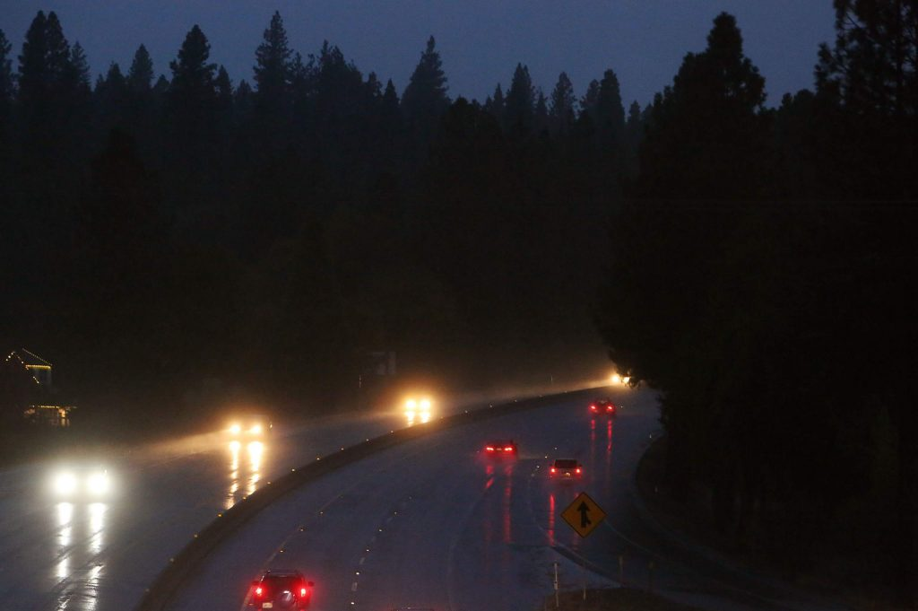 Vehicles navigate the Golden Center Freeway between Grass Valley and Nevada City as heavy rain begins to fall Tuesday evening in western Nevada County. Mountain snow levels started out at 6,500 feet Tuesday and are expected to drop to 5,500 feet today. Up to 2 feet of snow is forecast for Donner Summit.