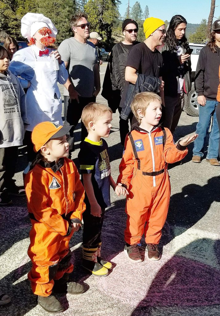 Costumes, including children dressed as astronauts, are part of the Muppet Launch festivities.