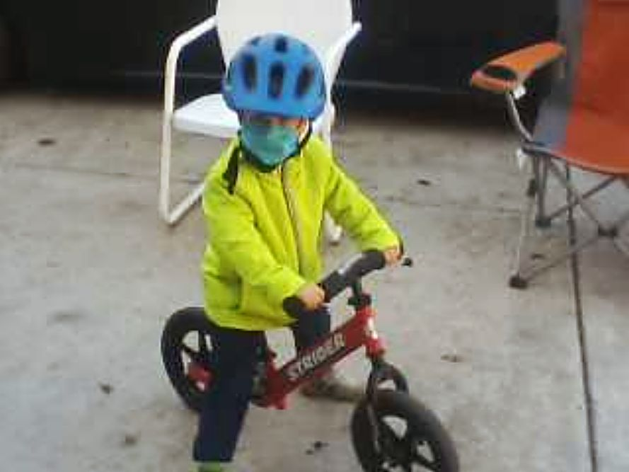 Wear a mask for safety! Grandson riding his bike.