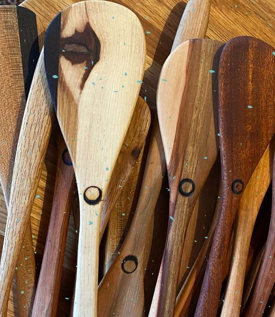 Bay Noel, a woodworker, creates wooden spoons, for sale at The Center's Holiday Market.