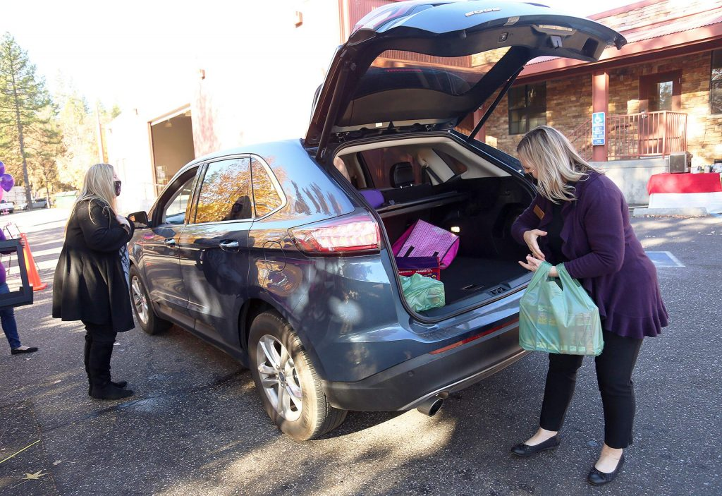 Employees from The Union newspaper help unload food from the trunk of a vehicle during a Food Bank of Nevada County drive-thru food donation day at The Union's parking lot. Food distributions are held at Grass Valley Seventh-day Adventist Church, 12889 Osborn Hill Road, every Thursday from 10 a.m. to noon, and at Oak Tree School, 18847 Oak Tree Road, North San Juan, on Tuesday, Dec. 8 from 10 a.m. to noon.