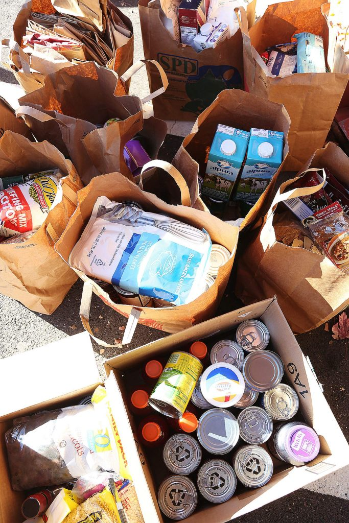 Paper bags full of canned and non-perishable goods amass near the entrance of The Union Wednesday, where a Food Bank of Nevada County food drive was held in time to help for the holidays.