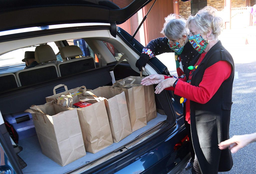 Food Bank of Nevada County volunteers help collect food during Wednesday's food drive at The Union.