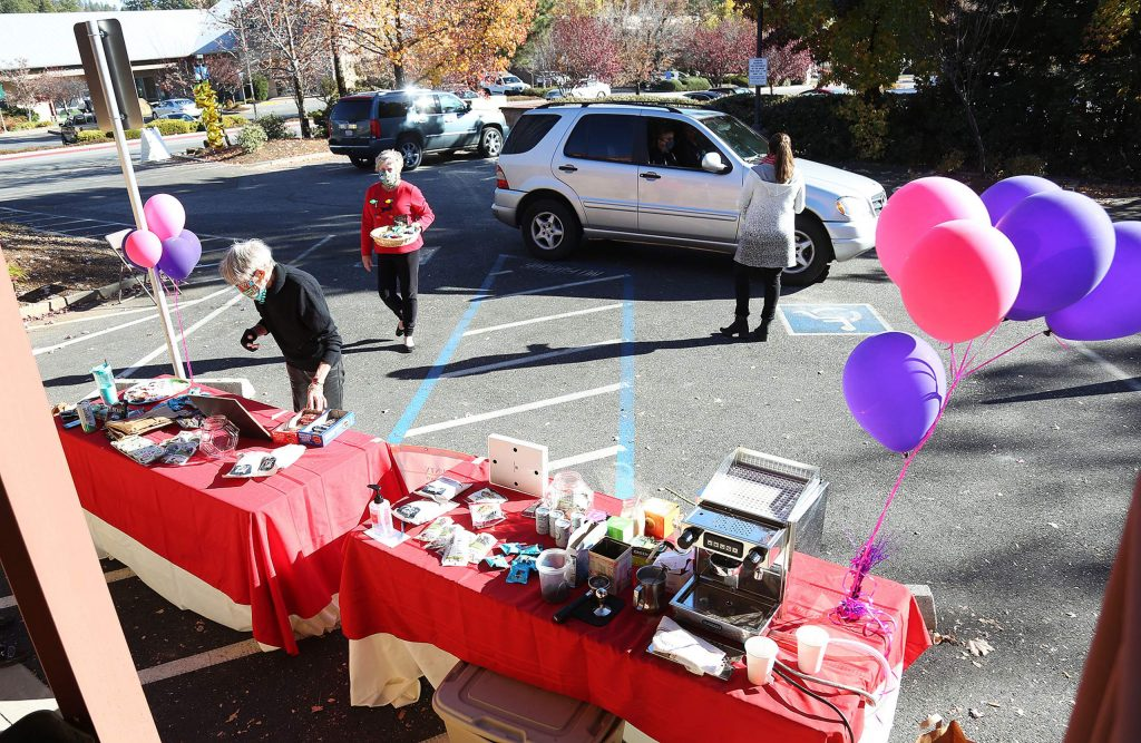 Vehicles drive through The Union parking lot one at a time to donate canned and non-perishable food items during a Food Bank of Nevada County food drive in time for the December holidays.