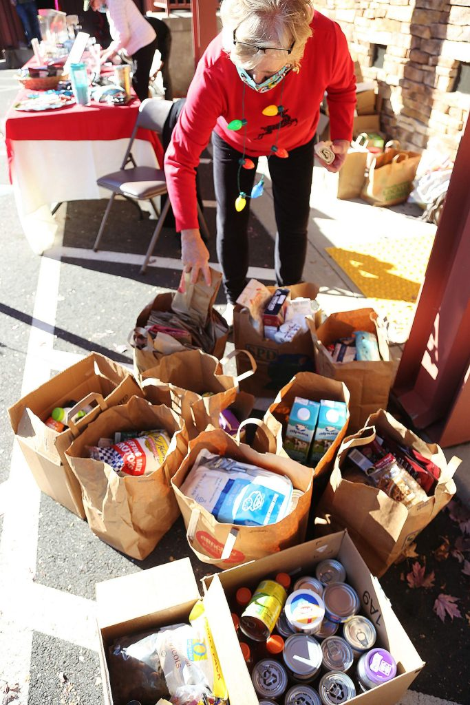 Food Bank of Nevada County volunteers help to collect food during Wednesday's food drive at The Union.
